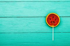 Watermelon summer candy food on blue wooden background. Top view. Mock up. Copy space. Sweet Lollipop.  royalty free stock photo