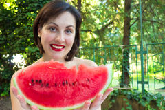 Watermelon - summer refreshment. Young woman hold red, ripe watermelon,photography Stock Photos