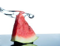 Watermelon and water splash  on white Royalty Free Stock Images