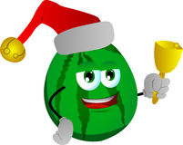 Watermelon wearing Santa's hat and playing bell Stock Images