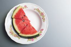 Watermelon in a white plate. stock photography