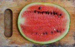 Watermelon on wood chop block Stock Photos
