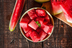 Watermelon on a wooden table Royalty Free Stock Images