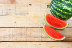 Watermelon on wooden table Stock Photo