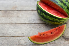 Watermelon on a wooden table Stock Photos
