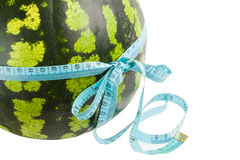 Watermelon wrapped around a measurement tape Royalty Free Stock Images
