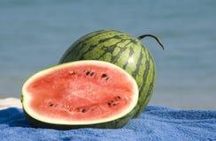 Watermelons on a beach Stock Photos