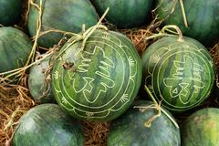 Watermelons with festive engraving on Eve of Vietnamese New Year. Hue, Vietnam.  stock image