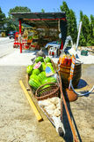 Watermelons at food stand. Watermelons in a boat and fresh homemade fruit juices on a barrel displayed at a food stand next to the river Neretva in Croatia royalty free stock image