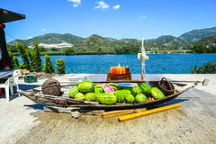 Watermelons at food stand. Watermelons in a boat and fresh homemade fruit juices on a barrel displayed at a food stand next to the river Neretva in Croatia royalty free stock photo