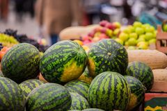 Watermelons, melons, vegetables and fruits at a street market in the city Stock Photography