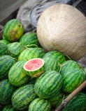 Watermelons and rice hat Royalty Free Stock Images