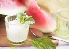 Watermelons and yogurt, shallow DOF. A glass of yogurt and watermelons, shallow DOF Stock Image