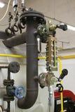 Watermerk in de gasboiler Stock Foto