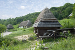 Watermill. Wooden watermill as a part of old-fashioned village Royalty Free Stock Photography
