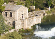 Watermill. Ancient watermill in the Tajo river in Toledo, Spain Royalty Free Stock Photography