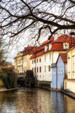 Watermill in the channels of Prague, Czechoslovakia. Prague, Czech Republic - April 04: Watermill in the channels of Prague, Czechoslovakia royalty free stock images