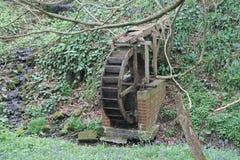 Watermill en el bosque Imagenes de archivo