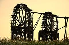 Watermill en la puesta del sol Imagen de archivo