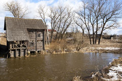 Watermill . Golshany Belarus. Unused old wooden mill located in the village of Golshany Belarus Stock Images