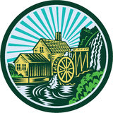 Watermill House Circle Retro. Illustration of a house with watermill falls river set inside circle with sunburst in the background done in retro woodcut style Stock Photography