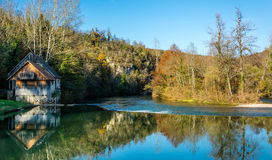 Watermill. Mill on the water with a reflection on the water surface Stock Image