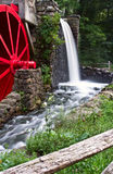 Watermill and millstone. Watermill with big red wheel, with water running royalty free stock photos