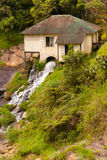Watermill on mountain river Stock Photography