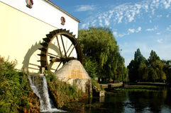 Watermill in parkland Royalty Free Stock Image