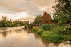 Watermill on the river sunset Royalty Free Stock Photos