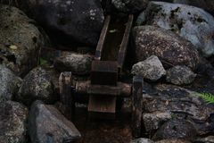 Watermill. Small watermill among tiny rocks Stock Image