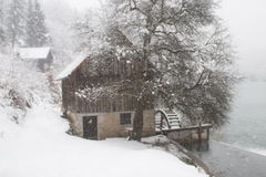Watermill and snowy river. Scenic view of old wooden watermill on Mrezina river in Winter, Karlovac, Croatia Royalty Free Stock Image