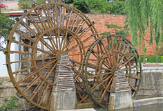 Watermill on the street in Lijiang, China Stock Images