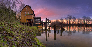 A watermill - sunset. A watermill with reflection in the countryside - sunset Slovakia - Jelka Panoramic view royalty free stock image