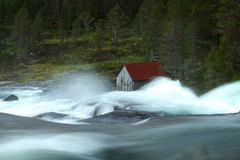 Watermill and waterfall. Wild river and mill in Norway Royalty Free Stock Image