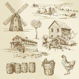 Watermill y molino de viento Fotos de archivo libres de regalías