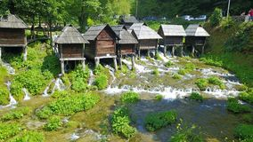 Watermills on the river Pliva. Not far from the town of Jajce, between large and small lake on Pliva, on the sedge barrier there are built watermills - Plivske Royalty Free Stock Image