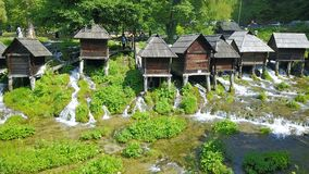 Watermills on the river Pliva. Not far from the town of Jajce, between large and small lake on Pliva, on the sedge barrier there are built watermills - Plivske Stock Image