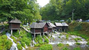 Watermills on the river Pliva. Not far from the town of Jajce, between large and small lake on Pliva, on the sedge barrier there are built watermills - Plivske Stock Photo