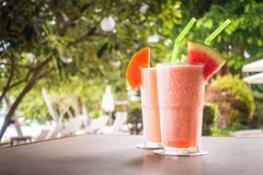 Watermon fruit and papaya juice smoothies in glass. For healthy food and drink stock photos
