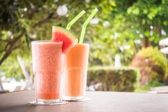Watermon fruit and papaya juice smoothies in glass. For healthy food and drink royalty free stock images