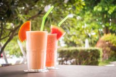 Watermon fruit and papaya juice smoothies in glass. For healthy food and drink stock photography