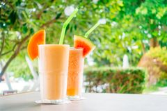 Watermon fruit and papaya juice smoothies in glass. For healthy food and drink royalty free stock photography