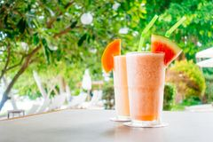 Watermon fruit and papaya juice smoothies in glass. For healthy food and drink stock photo