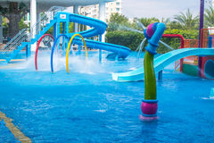 Waterpark. Colorful waterpark tubes and pool in tropical aquapark Royalty Free Stock Image