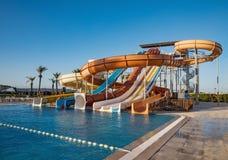 Waterpark in luxury tropical resort, water slide Royalty Free Stock Image