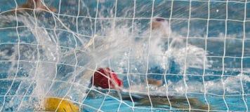 Waterpolo-Aktion Lizenzfreie Stockfotografie