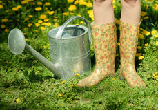Waterpot and rubber boots Royalty Free Stock Images