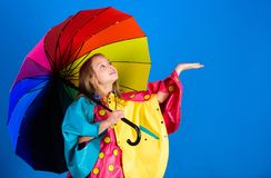 Waterproof accessories for children. Enjoy rainy weather with proper garments. Waterproof accessories make rainy day. Cheerful and pleasant. Kid girl happy hold stock photos