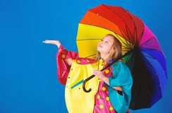 Waterproof accessories for children. Enjoy rainy weather with proper garments. Waterproof accessories make rainy day. Cheerful and pleasant. Kid girl happy hold stock photography